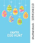 painted easter eggs hanging on... | Shutterstock .eps vector #1054146113