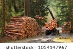 Stock photo lumberjack with modern harvester working in a forest wood as a source renewable energy 1054147967