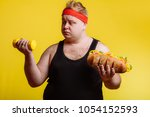 fat funny man is carried away... | Shutterstock . vector #1054152593