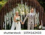 wedding ceremony. just married... | Shutterstock . vector #1054162433
