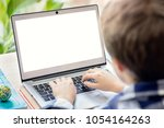 boy on the internet with laptop ... | Shutterstock . vector #1054164263