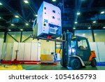 the forklift lifts the... | Shutterstock . vector #1054165793