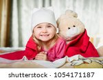 happy cute baby girl at pink... | Shutterstock . vector #1054171187