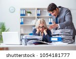angry irate boss yelling and... | Shutterstock . vector #1054181777