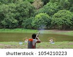 close up of man shooter is...   Shutterstock . vector #1054210223