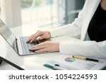 female using computer laptop... | Shutterstock . vector #1054224593