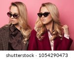 fashionable two blond women in... | Shutterstock . vector #1054290473
