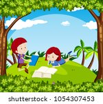 boy and girl reading book in... | Shutterstock .eps vector #1054307453