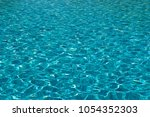 clear blue water in the... | Shutterstock . vector #1054352303