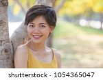 beautiful asian younger woman... | Shutterstock . vector #1054365047