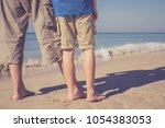 father and son standing on the... | Shutterstock . vector #1054383053