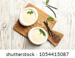 vanilla pudding  sticks and... | Shutterstock . vector #1054415087