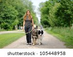 happy girl  walking with  dogs - stock photo