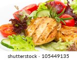 Closeup of grilled chicken fillet with vegetable salad - stock photo