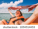 happy traveling girl on the... | Shutterstock . vector #1054514453