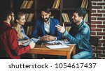 business team discussing a... | Shutterstock . vector #1054617437