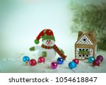 toy snowman and a gingerbread... | Shutterstock . vector #1054618847