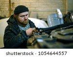 Mechanic Man Repairs The Car...