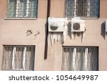 air conditioner with frozen ice ... | Shutterstock . vector #1054649987