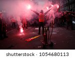 protesters of the french... | Shutterstock . vector #1054680113