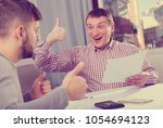 portrait of cheerful man... | Shutterstock . vector #1054694123