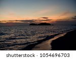the atmosphere around koh lipe... | Shutterstock . vector #1054696703