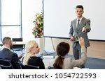 portrait of handsome successful ... | Shutterstock . vector #1054722593