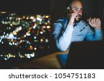 concentrated male entrepreneur... | Shutterstock . vector #1054751183