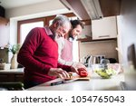 hipster son with his senior... | Shutterstock . vector #1054765043