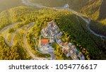 rosa khutor plateau  buildings  ... | Shutterstock . vector #1054776617