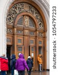 Small photo of MOSCOW, RUSSIA - MARCH 12, 2018: Arch with wooden gate of the entrance to the ring station of the Moscow metro line Prospekt Mira. The upper part is decorated with casting with symbols of the USSR