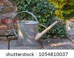 watering can in a garden   Shutterstock . vector #1054810037