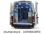 Small photo of Back view of mobile auto service on the chassis of all-metal van isolated on white