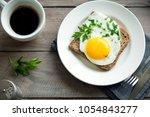 fried egg on wholegrain toast...   Shutterstock . vector #1054843277