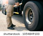 truck driver holding clipboard... | Shutterstock . vector #1054849103