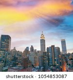 manhattan skyline at sunset ... | Shutterstock . vector #1054853087