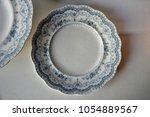 vintage ceramic tableware in... | Shutterstock . vector #1054889567