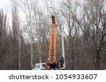 technician works in a bucket... | Shutterstock . vector #1054933607