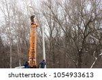 technician works in a bucket... | Shutterstock . vector #1054933613