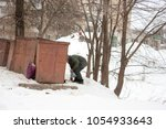 homeless old man in search for... | Shutterstock . vector #1054933643