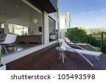 wooden outdoor deck in modern Australian mansion - stock photo