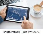 investor watching the change of ... | Shutterstock . vector #1054948073
