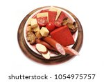 cheese plate. dutch red cheese. ... | Shutterstock . vector #1054975757