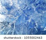 textured ice blue frozen rink... | Shutterstock . vector #1055002463