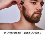 close up image of handsome man... | Shutterstock . vector #1055004053