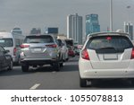 traffic jam with row of cars on ... | Shutterstock . vector #1055078813