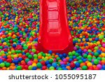 lots of colored balls in a... | Shutterstock . vector #1055095187