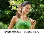 young woman with mp3 player... | Shutterstock . vector #105514577