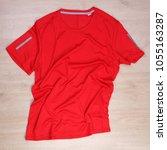rrinkled red running tshirt on... | Shutterstock . vector #1055163287