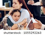 red haired sad woman hugs... | Shutterstock . vector #1055292263